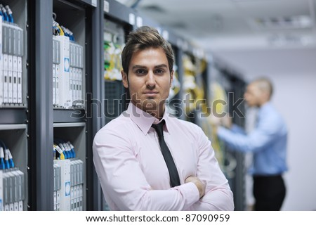 group of young business people it engineer in network server room solving problems and give help and support #87090959