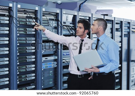 group of young business people it engineer in network server room solving problems and give help and support #92065760