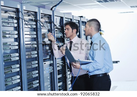 group of young business people it engineer in network server room solving problems and give help and support #92065832