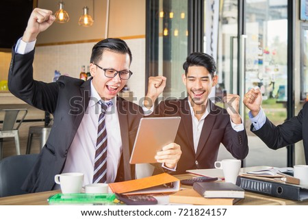 Group of young businessman colleagues cheering excited in celebration after got a good news with stock trading success, win a good contract, success deal or get reward. #721824157