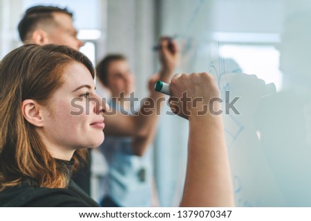 Group of young casually dressed business people having meeting at athe modern office room planning new startup. Teamwork concept. Close up shot.