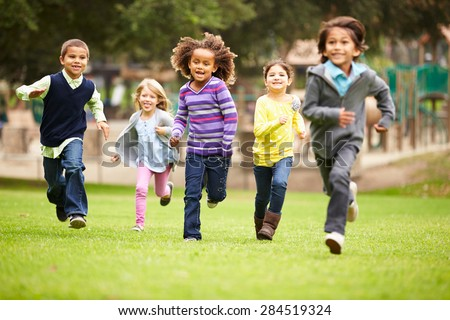 Group Of Young Children Running Towards Camera In Park #284519324