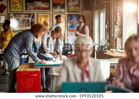Group of young creative people working in a pleasant atmosphere at office. Employees, office, work