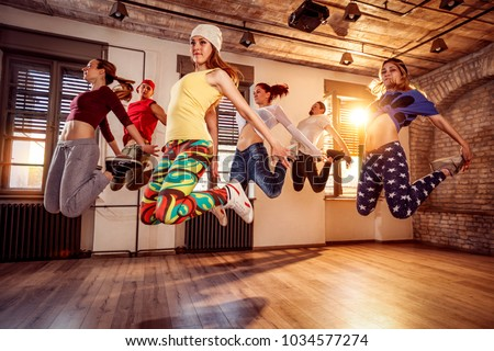 Group of young dancer people jumping during music Stockfoto ©