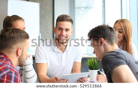 Group of young designers making sketches in office #529511866