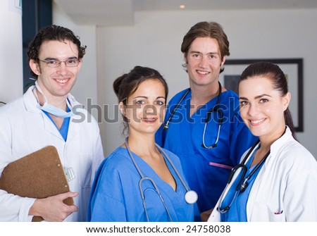 group of young doctors and nurses in hospital - stock photo