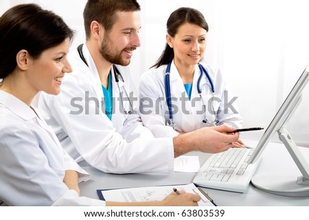 Group of young doctors discuss work