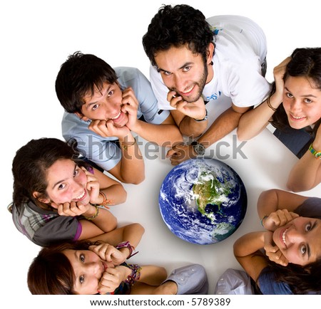group of young ecologists smiling at the camera with a globe in the middle of them