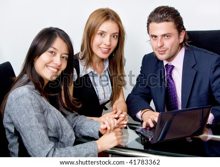 Group of young executives working at the office