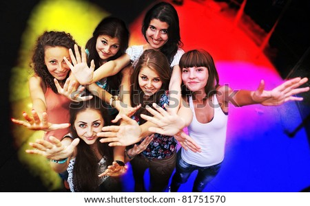 Group of young friends dancing at a night club
