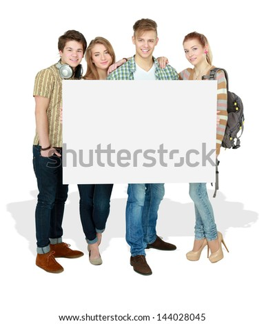 Group of young friends holding a blank board, isolated on white background