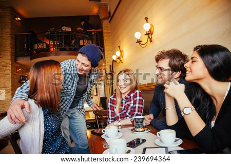 Group Of Young Friends Meeting In Cafe #239694364