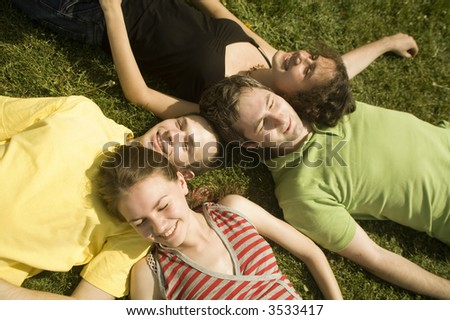 group of young friends on the grass