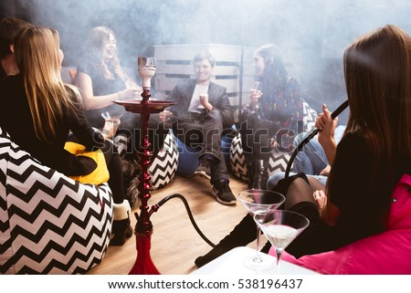 Group of young friends relaxing in shisha club-bar #538196437