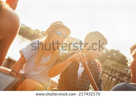 Group Of Young Friends Relaxing On A Boat Enjoying Sunny Day