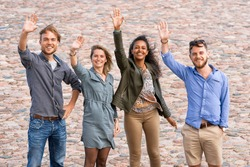 Group of young friends waving their hands as a gesture of saying goodbye Concept