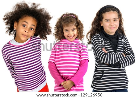 Group of young girls posing isolated in white