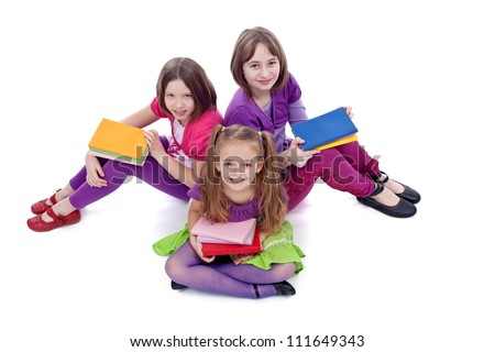 Group of young girls preparing to go back to school - on white background - stock photo