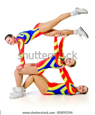 group of young gymnasts on a white background.sporting exercise.plastic study.aerobics.flexibility.sport.active rest.