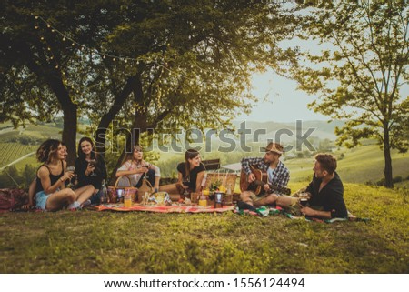 Group of young happy friends having pic-nic outdoors - People having fun and celebrating while grilling ata barbacue party in a countryside Stock fotó ©