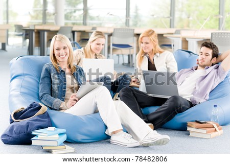 Group of young high-school or university students  learning and relaxing