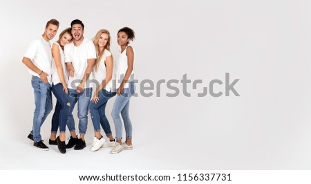 Group of young multi-ethnic attractive people wearing white shirts, smiling and having fun together, posing in studio. #1156337731