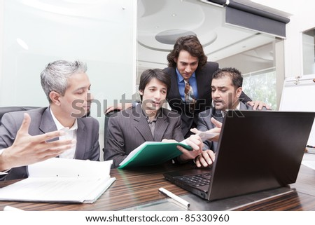 group of young multiracial businessmen in a meeting