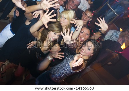 people dancing in a club. young people dancing and
