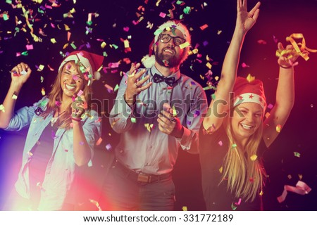 Group of young people dancing and having fun at a New Year's Eve Party stock photo