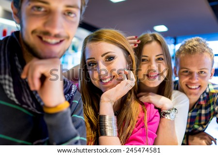 Group of young people enjoying and having fun smiling