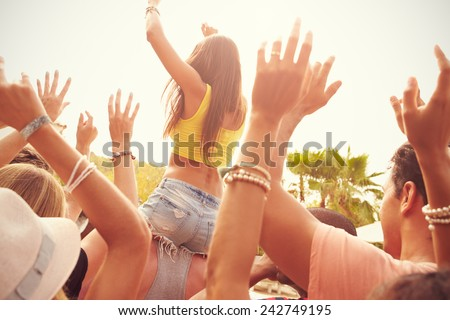 Group Of Young People Enjoying Outdoor Music Festival