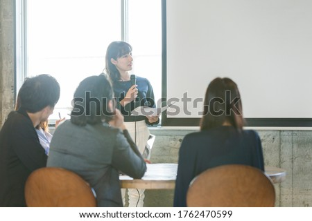 Group of young people having a meeting