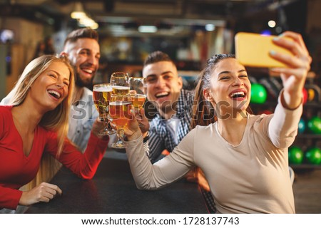 Group of young people having fun in a night and taking selfie