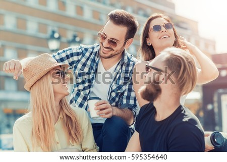 Group of young people having fun together outdoors.