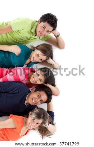 Group of young people lying on the floor - isolated over a white