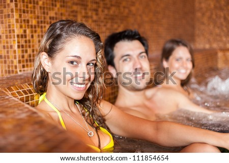 Group of young people relaxing in a spa