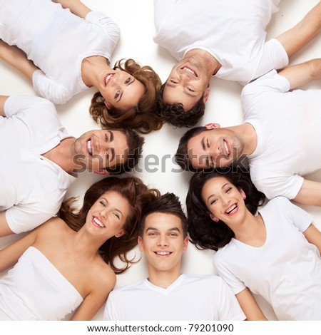 group of young people smiling in circle
