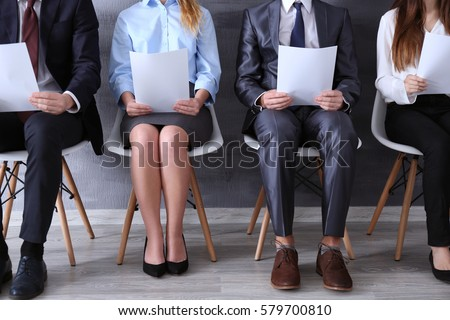 Group of young people waiting for interview indoors - Shutterstock ID 579700810