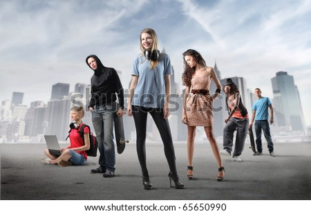 Group of young people with cityscape on the background stock photo