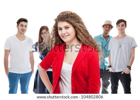 Group of young people with one standing out of the crowd. Focus on the person in front.