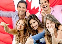 Group of young people with thumbs up and the flag of Canada