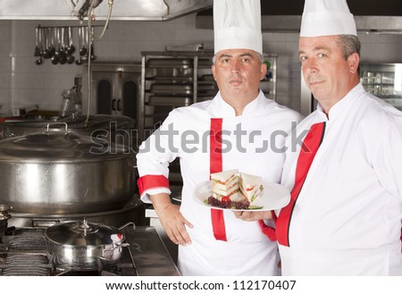group of young professional chefs portrait in industrial kitchen