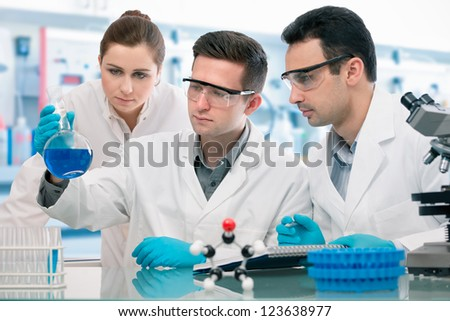 Group of young scientists experimentation in research laboratory