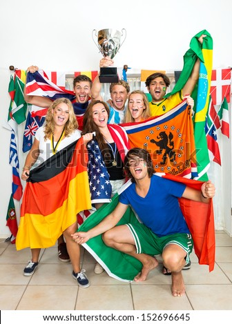 Group of young sports fans from various nations all over the world, celebrating and cheering together