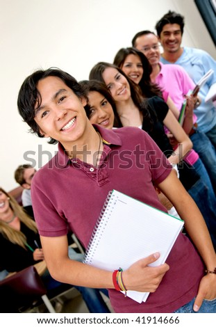 Group of young students at the university smiling