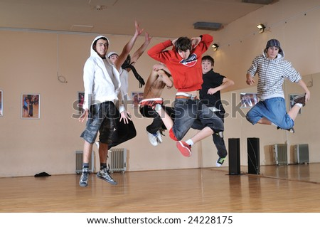group of young teens jump in air together