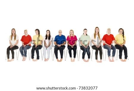 Group of Young women sitting on chairs wearing colorfull t-shirts
