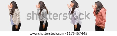 Group or collection of indian young woman wearing different clothes whispering gossip undertone, trying not to be heard, is warning of a possible weakness or an opportunity