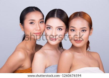 Group Pack of Beautiful Clean Skin three Asian Woman straight black hair hands arms fingers face pose open shoulder smile, studio lighting white background copy space, aesthetics skincare treatment #1260676594