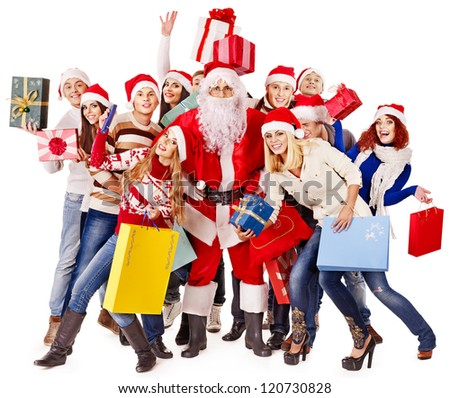 Group people and  Santa holding gift box near  Christmas tree.